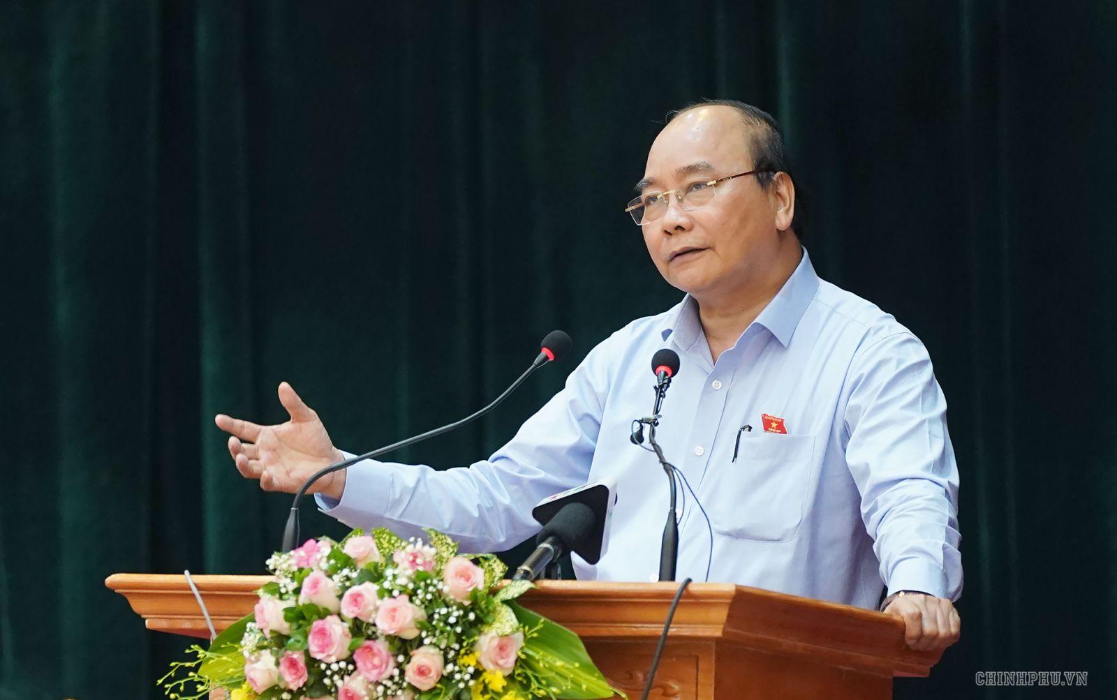 Thủ tướng phát biểu tại cuộc tiếp xúc cử tri. Ảnh: VGP/Quang Hiếu