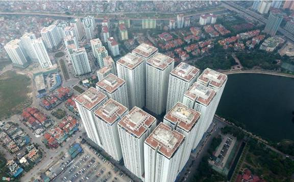 Tại KĐT Linh Đàm, nhiều tòa nhà mọc san sát nhau bó hẹp không gian sống của người dân. (Ảnh: Zing.vn)