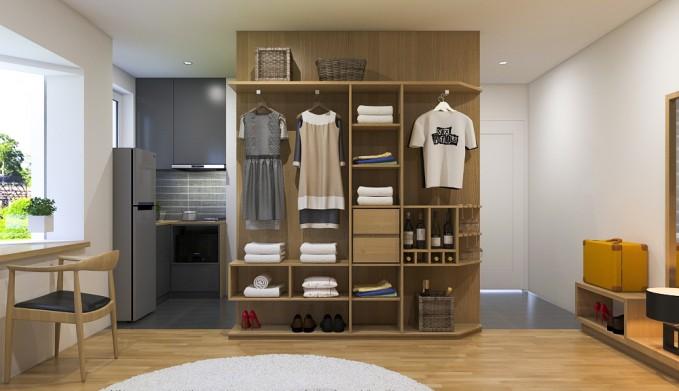 Tủ đựng đồ cao sát trần nhà, được thiết kế  nhiều ngăn tủ nhỏ để lưu trữ được nhiều vật dụng và quần áo. Góc nhỏ bên cạnh là gian bếp, nơi nấu nướng, đầy đủ thiết bị tủ lạnh và lò vi sóng.