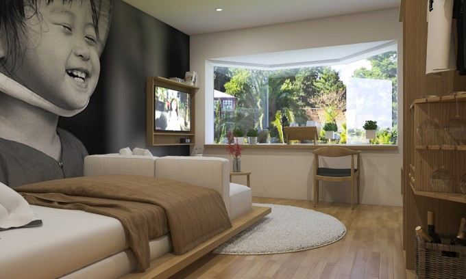 Studio tận dụng được tối đa ánh sáng vào nhà đó bằng cửa sổ kính lớn, giúp ánh sáng tràn vào nhà một cách dễ dàng.