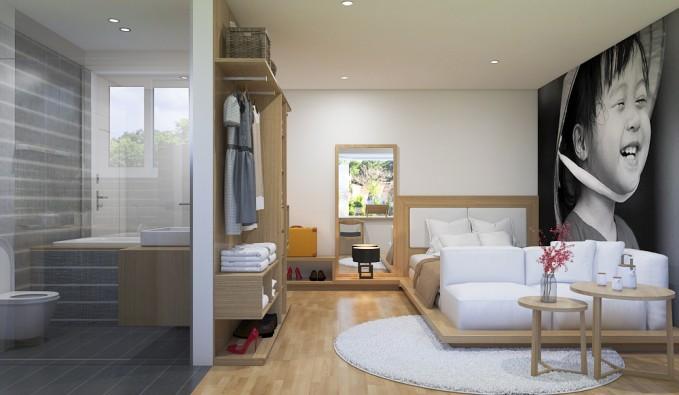 Giường được kết hợp với ghế sofa, ngay cạnh là bàn tiếp khách nhỏ gọn và xinh xắn.
